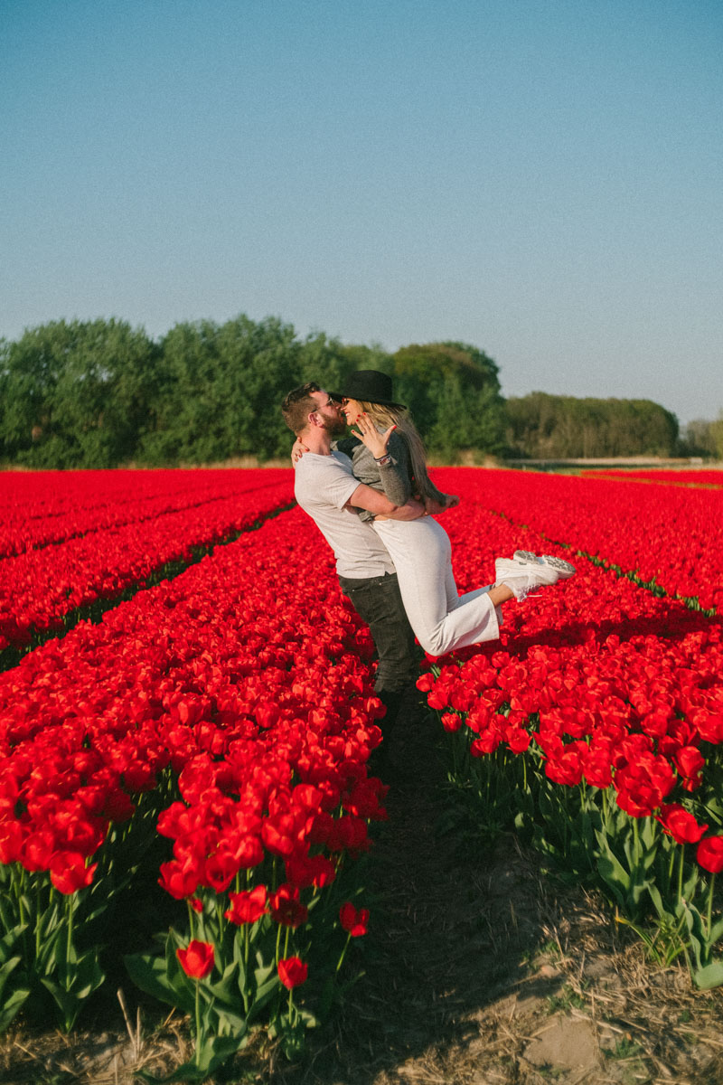 surprise proposal photography tulip field