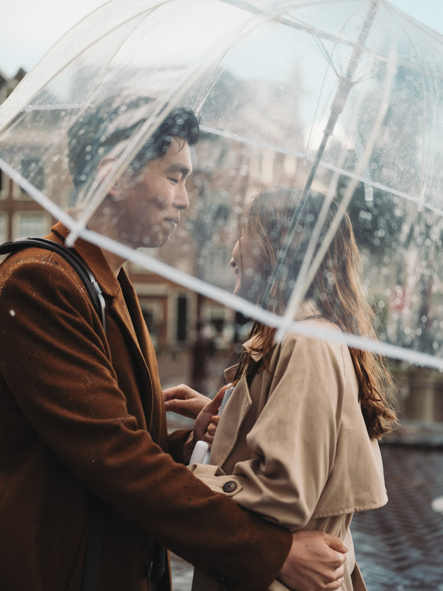 couple rain amsterdam proposal