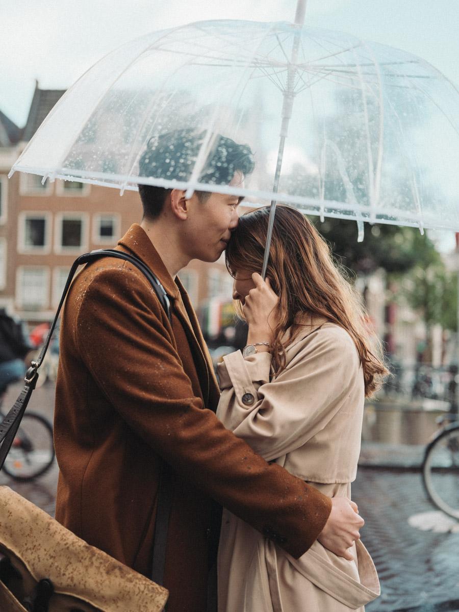 Singing in the Rain Under Umbrella